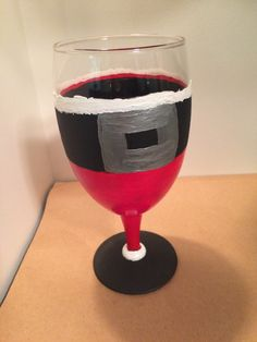 A personal favorite from my Etsy shop https://www.etsy.com/listing/256853373/hand-painted-christmas-wine-glass