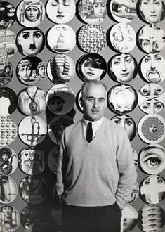 """Piero Fornasetti with some plate of """"Tema e Variazioni"""" series behind him"""