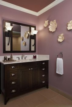 I'm not crazy about the wall color or cream wall decor with the vanity but love the mirror, sconces and vanity!