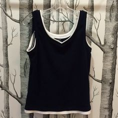 "HP Athletic tank top *was $20 Athletic tank top in black and white from Jones New York Sport. White lining in collar, underarms, and hem.  Size Medium. Measures 18"" armpit to armpit, 16"" across waist, 24"" shoulder to hem.  Machine wash. 100% cotton. No flaws. Host pick 9/16 Essential Style Jones New York Tops Tank Tops"
