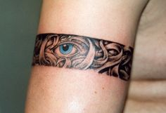 seeing eye armband tattoo via the tattoo studio