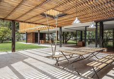 """Roberto Burneo designed this home for his eldest niece, her husband, and their three young children in a suburb outside Quito, the capital of Ecuador. The house is set on a flat expanse of land with fruit trees, and Burneo's design """"guides the social areas inward in order to link them to the gardens."""""""