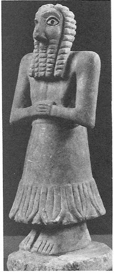 Figure of Khafaje, c. 2,700 BCE. Ancient Sumerian figures are stylized, with big wide eyes, and stiff bodies with no extending limbs.