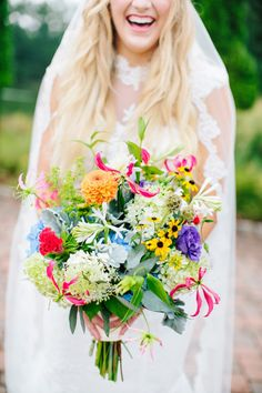 Bright wildflower bouquet: http://www.stylemepretty.com/2015/06/04/whimsical-boho-chic-wedding-in-north-carolina/ | Photography: Millie Holloman - http://www.millieholloman.com/