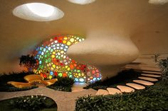 Living in a Shell - Nautilus House  this cob... the light and glass and play{ful}ness ... amazing