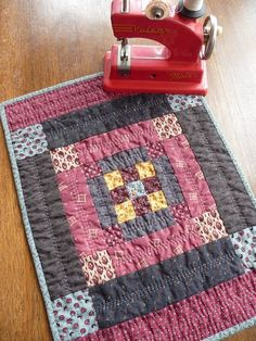Oh, how pretty. This lady makes the nicest repro quilts. Look at her blog.