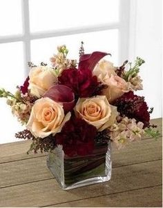 This is a beautiful square vase, simply done for a table setting.  Add height by pairing this with a tall vase of flowers with lights or floating led lights.
