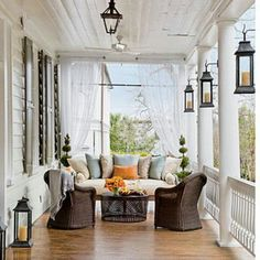 For the upstairs porch. Loveseat and two arm chairs with table. Lanterns on columns.
