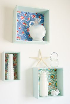 Wall boxes for the bathroom only with pretty glass tile on the back instead of fabric.