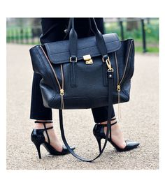 because I always walk around in heels with the straps of my beautiful designer bag hitting the pavement. This is an accident waiting to happen. Double dutch anyone?