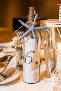 blue starfish accented message in a bottle table number
