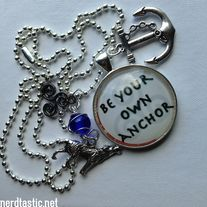 """This necklace is inspired by the Teen Wolf quote """"Be your own anchor"""".  The charms include a 30mm quote medallion, a gunmetal triskele, a 30mm anchor charm, a silver tone wolf charm on a wire wrapped glass bead.     :: All necklaces will be sent to you in an organza gift bag. :: This necklace ..."""