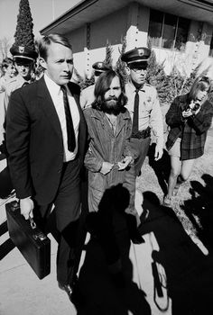 Charles Manson is led to court for a grand jury appearance in California in 1969