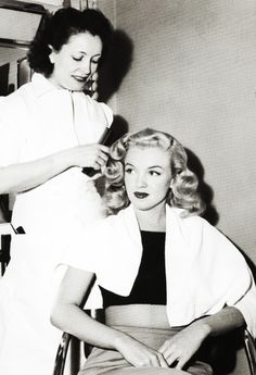 Marilyn Monroe has her hair done by Columbia's stylist, Helen Hunt, 1948.