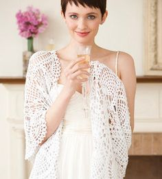 If you have an early spring wedding but don't want to cover your gorgeous gown with a not-so-glam coat, whip up a Light Lace Bridal Shawl. #DIYBridalAttire #FreeCrochetPatterns