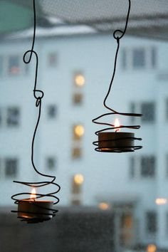 Wired Tea Lights. Simply twist coated wire (jewelry supplies any craft store) using pliers around a tea light.