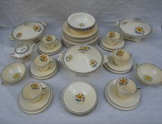 An early Crown Ducal part dinner service, designed by Charlotte Rhead in the 3122 pattern, Soup Bowls, The Saleroom, Side Plates, Sprays, Dinner Plates, 1930s, Charlotte, September, Pottery