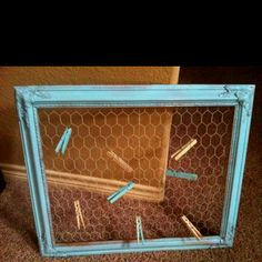 Easy DIY! Get an old wooden frame, chicken wire, wire cutters, spraypaint, a staple gun and some clothespins