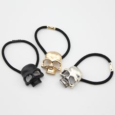 we just got the gold skull hair tie in today!