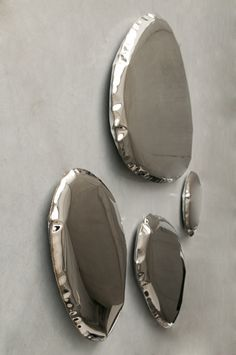 Creative studio Zieta have designed TAFLA, a modular collection of mirrors made from steel that have a unique, bionic form.