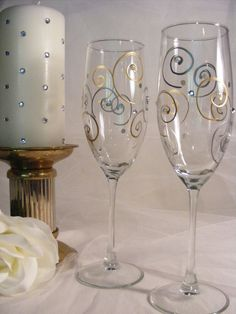 Painted champagne glsses are Absolutely beautiful and elegant and can be personalized. This pair of slightly oversized champagne glasses has a