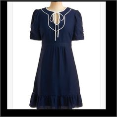 Esley navy dress Navy blue with white piping. Adorable ruffles and flares slightly at the bottom. Tag says small but fits more like xs. Worn a free times but in excellent condition. ModCloth Dresses Midi
