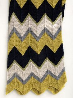 This easy knit ripple afghan is a classic and can be customized to your grad's favorite colors.