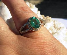 Emerald engagement ring. I'm obsessed!