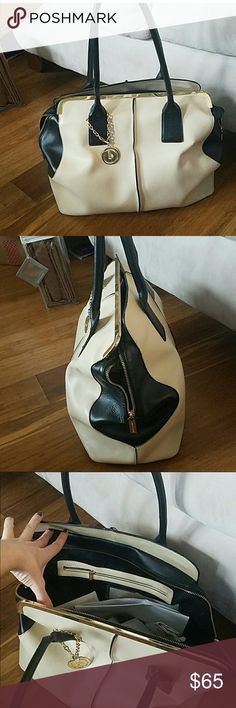 """Charles Jourdan handbag Black and Cream Charles Jourdan medium sized handbag. 15 x 12 x 6.5 with 9"""" strap drop  A couple stitches are out on strap. Purchased from another Posher and just don't use enough. Looking to get my money back so price is firm. Charles Jourdan Bags"""