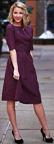 I love her dress! Great plum color and quarter length sleeves