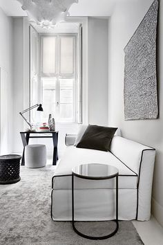This sofa fits into the modern era because of the clean, minimalist design and contrasting black and white colouring.