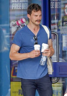 Jamie Dornan was just running errands like a normal person in London on Monday. Focused on wife Amelia Warner and daughter Dulcie Dornan, Jamie looked completely unaware that his mustache might have a big impact on his fans. Sure, we've seen Jamie with