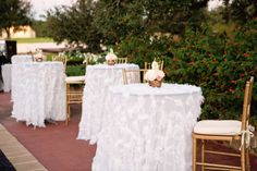 The alfresco cocktail hour was decorated with golden chairs and tables covered with white feather-embellished linens. Tent Reception, Reception Decorations, Flower Decorations, Romantic Weddings, Elegant Wedding, Summer Cocktails, Anniversary Parties, Cocktail Tables, Spring Wedding