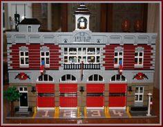 LEGO modular fan has combined a few sets side-by-side to . Lego City Fire Station, Lego Simpsons, Lego Fire, Lego Police, Engine House, Lego Boards, Fire Equipment, Lego Modular, Cool Lego Creations