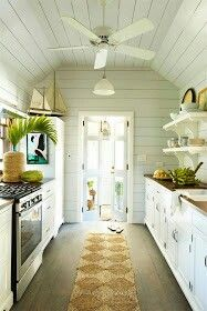 Bright Fresh Galley Kitchen With Nautical Flair Kitchen Kitchens Kitchenideas Beach House Kitchens Beach House Interior White Beach Houses