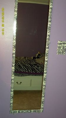 $5 mirror, zebra duct tape on frame - I have the mirror and I'll find other tape.  Awesome idea.