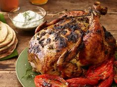 Herb-Roasted Chicken with Melted Tomatoes: The herb mixture in this recipe plays two roles. Half of it serves as a flavorful rub for the chicken, and the other half is mixed with yogurt for a cool table sauce.