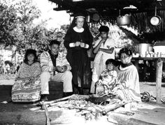 74 year old Deaconess Bedell with Mikasuki (Miccosukee) leader Ingram Billy (Billie) and his family - Everglades, Florida.