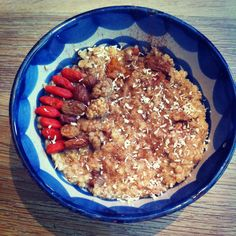 Cooked Oatmeal With Overnight Soaked Gojiberries, Mulberries, Raisins, Inca Berries And Cranberries, Stirred With Honey And Topped With Coconut Flakes, Cinnamon And A Few Berries