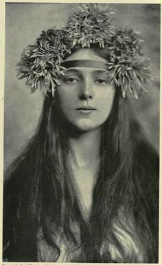 Vintage portrait of girl with flowers in her hair