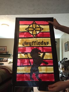 Tissue paper Harry Potter stained glass! Made with my cricut and online stencils I printed off!
