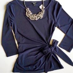 Sale NWT Ann Taylor Tie Waist/Wrap Blouse A beautiful and classic style blouse with 3/4 sleeves and adorable tie waist bow that wraps around back and ties on the side.  Deep navy blue. 96% Polyester 4% Spandex Ann Taylor Tops Blouses