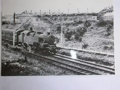 Steam train passing through Basildon near Staneway bridge. Lee Chapel South under construction in the background.