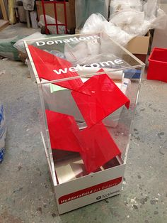 "Interactive donation box.  Good for both coins and paper ""folding money""."