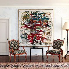 Legendary Designer Robert Couturier's Private Paradise: A large piece of abstract art nestles between two rococo Louis XV chairs.