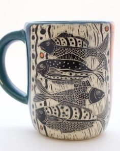 Mug- Fish with Orange and Blue Glaze Patrticia Griffin is a ceramic artist making vessels, wall-hangings and functional pottery with etched designs that look like woodcuts and scrimshaw. Visit her studio at 1601 Main Street in Cambria, Ca. Pottery Mugs, Ceramic Pottery, Pottery Art, Pottery Painting, Ceramic Painting, Keramik Design, Clay Mugs, Art Textile, Paperclay