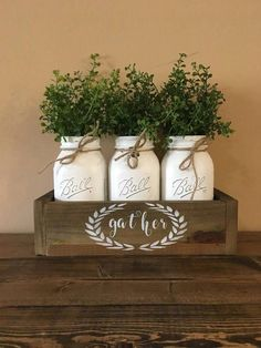 Add a custom touch to your home with this rustic mason jar centerpiece! All jars can be changed to fit your decor along with the flowers upon special request. Package includes: 3 jar planter box HAND PAINTED stencil mason jars flowers Measurements without Mason Jar Projects, Mason Jar Crafts, Mason Jar Diy, Kitchen Centerpiece, Mason Jar Centerpieces, Wedding Centerpieces, Diy Casa, Rustic Mason Jars, Christmas Mason Jars