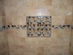 Glass Tile Inset Shower Shelf - hate these particular tiles, but love the inset shelf and accent tile idea.