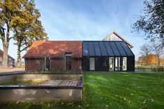 Bureau Fraai has completely renovated a 50's farmhouse and extended the existing old barn next to the house with a contemporary extension. With the design of...