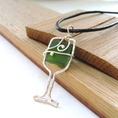 Wine Glass Necklace, recycled wine bottle, Finger Lakes Wine, Silver & Leather cord   $30 www.LaketoLakeJewelry.com  www.Facebook.com/LaketolakeJewelry